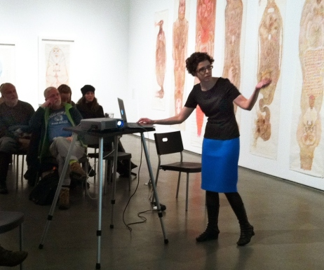 Carla lecturing at a museum cropped